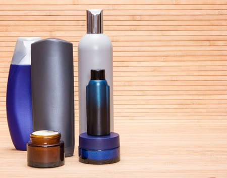 Mens cosmetics. Various cosmetic products for men on a wooden surface