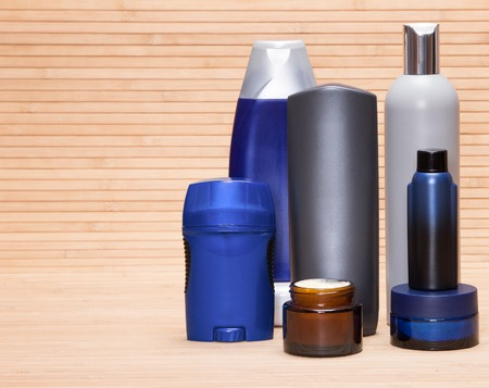 skin care products: Mens cosmetics. Various cosmetic products for men on a wooden surface. Copy space