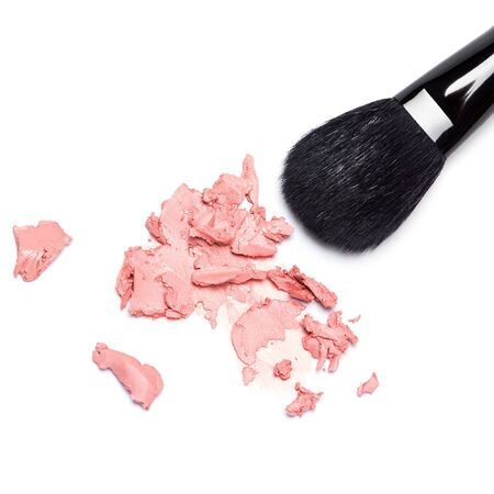 smeared: Close-up of smeared pink cream blush with makeup brush on white background. Top view. Square crop