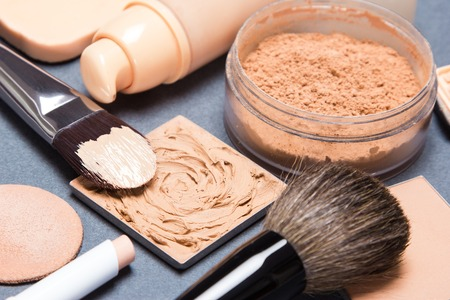 Set of makeup products and accessories to even out skin tone and complexion. Shallow depth of field