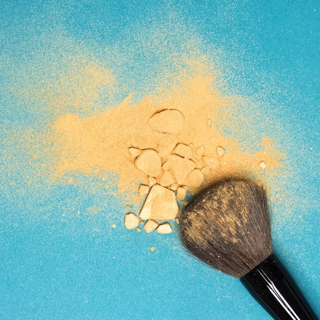 shimmer: Close-up of crushed mineral shimmer powder with cosmetic brush Stock Photo