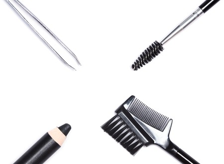 Accessories for care of the brows: eyebrow pencil, tweezers, brush and comb on white background. Eyebrow grooming tools