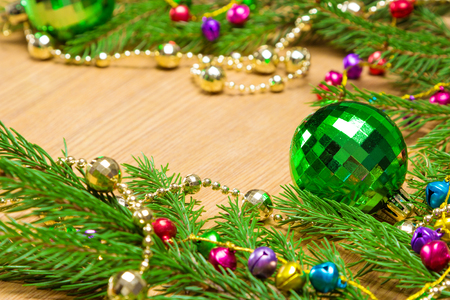 christmas and new year festive background green christmas ball garland of varicolored bells and
