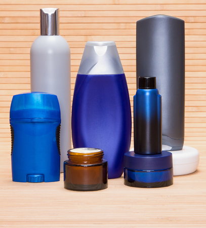 aftershave: Mens cosmetics. Face and body moisturizing creams, aftershave lotion, antiperspirant deodorant and other cosmetic products for men on wooden surface Stock Photo