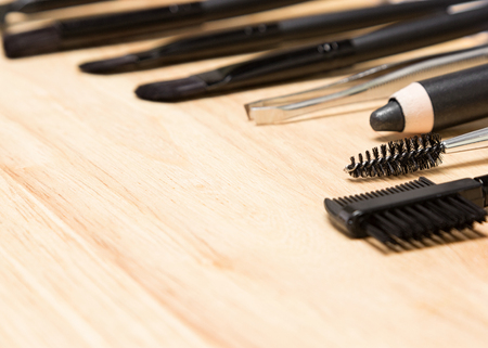 plucking: Accessories for eyebrow grooming. Professional tools of make up artist. Shallow depth of field. Copy space Stock Photo