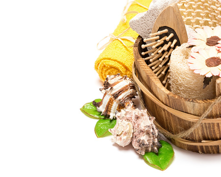 Peeling and spa accessories in wooden basket on white background. Copy space