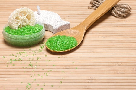 exfoliation: Sea salt, loofah, pumice on wooden background with copy space. Natural products and accessories for peeling and exfoliation Stock Photo