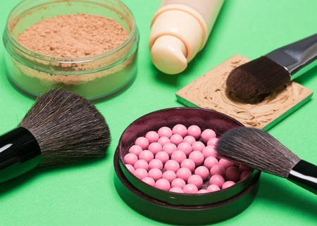 loose skin: Basic makeup products to create beautiful complexion: foundation, powder, blush with makeup brushes