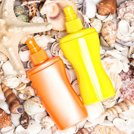 Sunscreen cosmetic products with shells and starfish. Skin care cosmetics containing sun protection factor for beach vacation