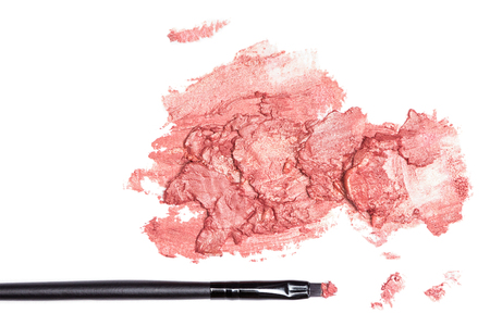 Close-up of smeared lipstick with makeup brush on white background Stock Photo