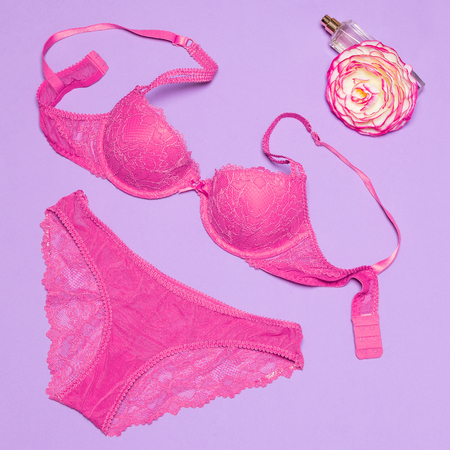 Sexy lace lingerie set of push up bra and panties with perfume and flower. Womens accessories. Female attraction secrets Stock Photo