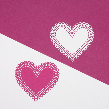 Be my Valentine. Two paper hearts magenta and white colors disposed by diagonal. Love and romantic concept