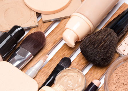 Foundation makeup products with professional brushes. Close-up, selective focus
