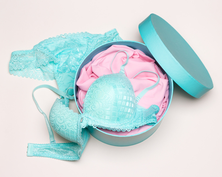 Open round gift box with lingerie set. Beautiful women underwear. Close-up, top view Stock Photo