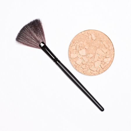 Round cosmetic container of crushed compact powder with fan make-up brush on white background, copy space Stock fotó