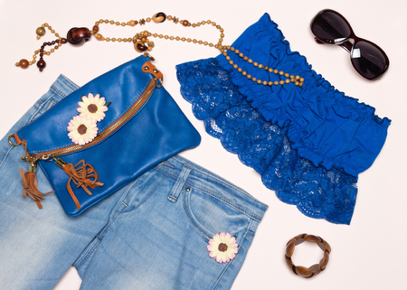 Fashion summer outfit. Jeans, bando top, pouch, long necklace, bracelet and sunglasses. Trendy women clothing and accessories