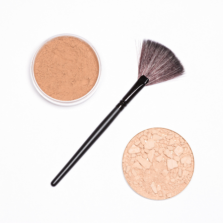 Make-up brush with round jars of loose and crushed compact powder in the form of percent sign. Discounts on cosmetics, makeup sale concept