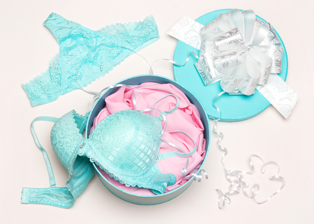 Underwear as present for beloved woman. Open round gift box with sexy lingerie set Stock Photo