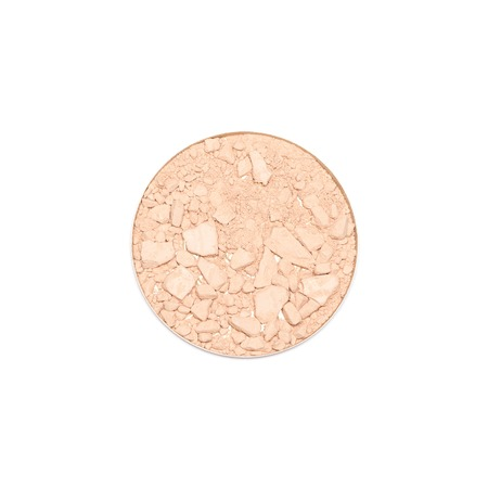 Round cosmetic container of crushed compact face powder isolated on white background, close-up