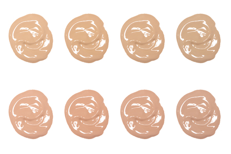 Different colors and shades of liquid fluid foundation isolated on white background. Beauty makeup product swatches