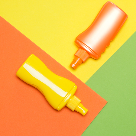 Suntan lotions on multi-colored blocks. Bright summer design 스톡 콘텐츠