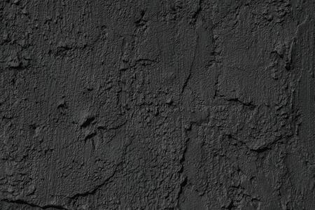 Black cement plaster smears texture. Dark concrete wall background. Matte coating