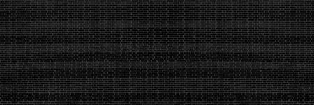 Wide black brick wall. Dark spacious brickwork texture. Gloomy grunge background 版權商用圖片