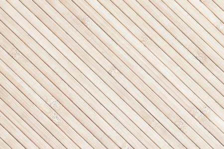 Light bamboo diagonal slats background. Natural texture Stock Photo