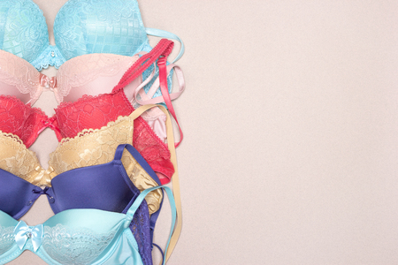 Row of lace push-up bras. Various colored brassieres. Fashion shopping background with copy space