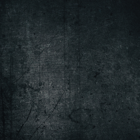 Black color painted metal texture. Aged dark gray scratched shabby metallic surface. Retro grunge background