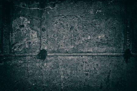 Dark rough concrete wall texture. Urban gloomy grunge background Standard-Bild