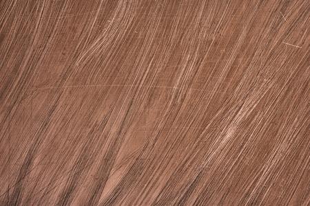 Scratched metal surface texture. Bronze metallic background