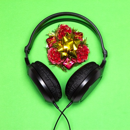 Headphones and New Year decorations. Christmas party music playlist. Xmas songs minimal concept