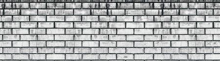 Wide old white shabby brick wall texture. Light gray aged masonry panorama. Whitewashed brickwork panoramic grunge background