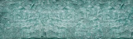 Dark turquoise cracked concrete wall wide texture. Weathered cement surface panoramic retro background. Blue vintage backdrop