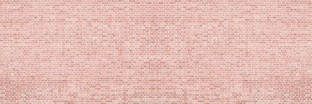 Wide red brick wall texture. Light orange panoramic vintage background Фото со стока