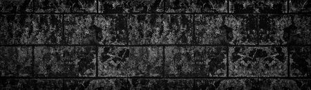 Wide black shabby concrete wall texture. Dark old cracked cement surface panorama. Grunge panoramic background Standard-Bild