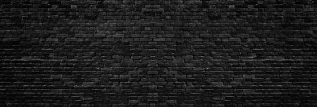 Black rough brick wall wide texture. Dark brickwork panoramic background