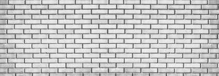 Wide light gray brick wall texture. Whitewashed panoramic vintage background Standard-Bild
