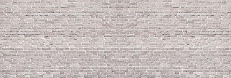Wide light brick wall texture. Rough brickwork panoramic vintage background