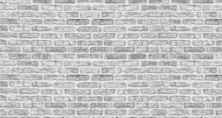 White washed brick wall texture. Rough light gray brickwork. Whitewashed vintage background