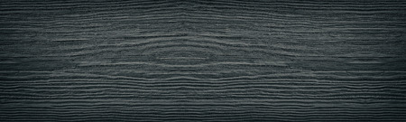 Old cracked black painted solid wooden surface wide texture. Dark gray wood panoramic retro background