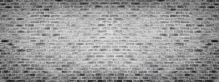 Wide gray rough brick wall texture. Old masonry panorama. Panoramic brickwork background