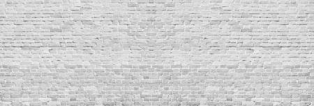 Wide white washed brick wall texture. Rough light gray vintage brickwork. Whitewashed panoramic background