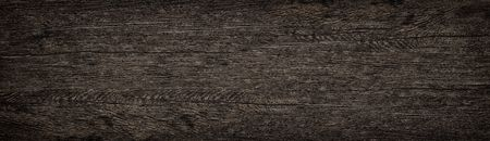 Wooden solid surface wide texture. Dark brown wood panoramic background Фото со стока
