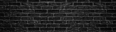 Wide black brick wall texture. Dark brickwork panoramic background