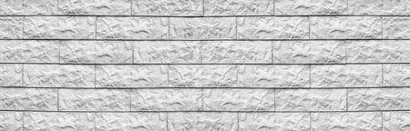Wide white cement tile wide texture. Whitewashed stone block masonry panoramic background. Rough brick wall panorama