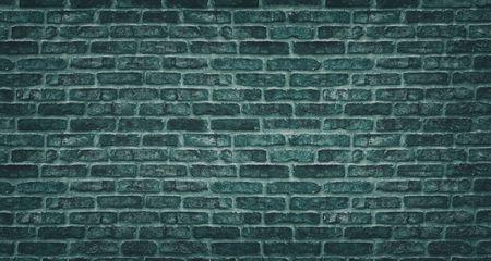 Teal brick wall texture. Dark stone block masonry. Old rough brickwork vintage background Фото со стока
