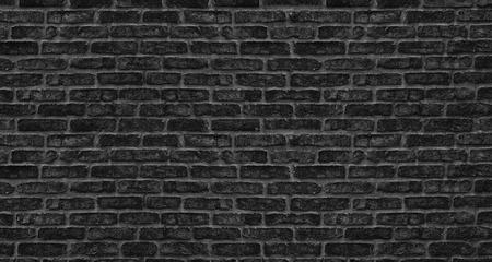 Black brick wall texture. Old rough brickwork. Dark grunge background Фото со стока