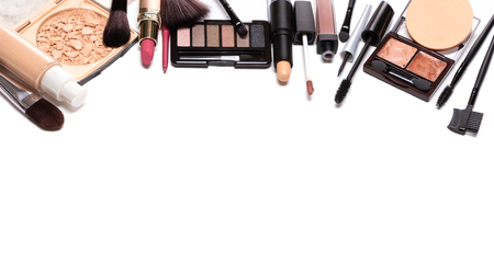 Day makeup set with copy space. Beauty products for natural make-up isolated on white. Decorative cosmetics background Фото со стока